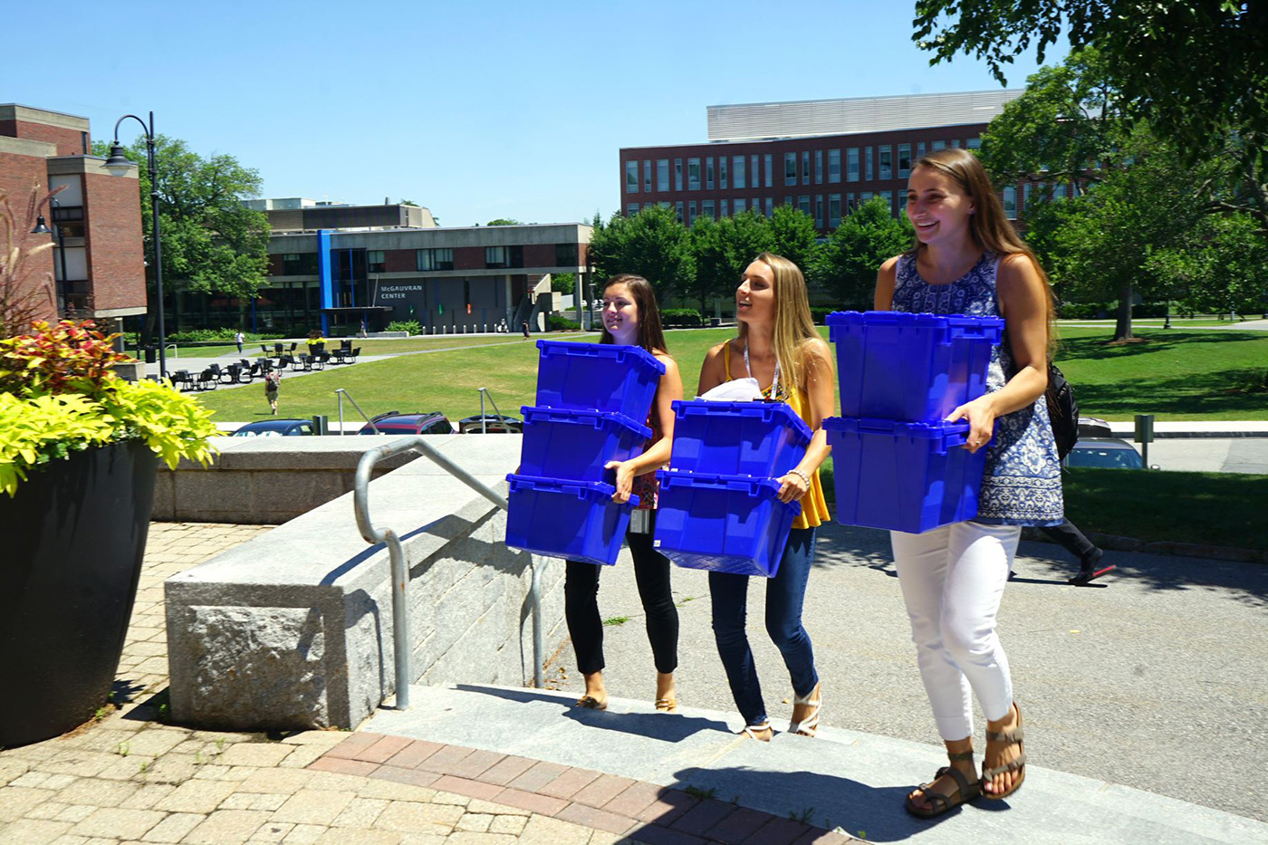 Three female UMass Lowell students carrying blue recycling bins. The UMass Lowell Sustainability team along with our partner Mill City Grows is conducting a Community Supported Agriculture (CSA) program to provide the UMass Lowell community with locally grown, farm fresh produce to promote sustainable urban agriculture and ensure community well-being.