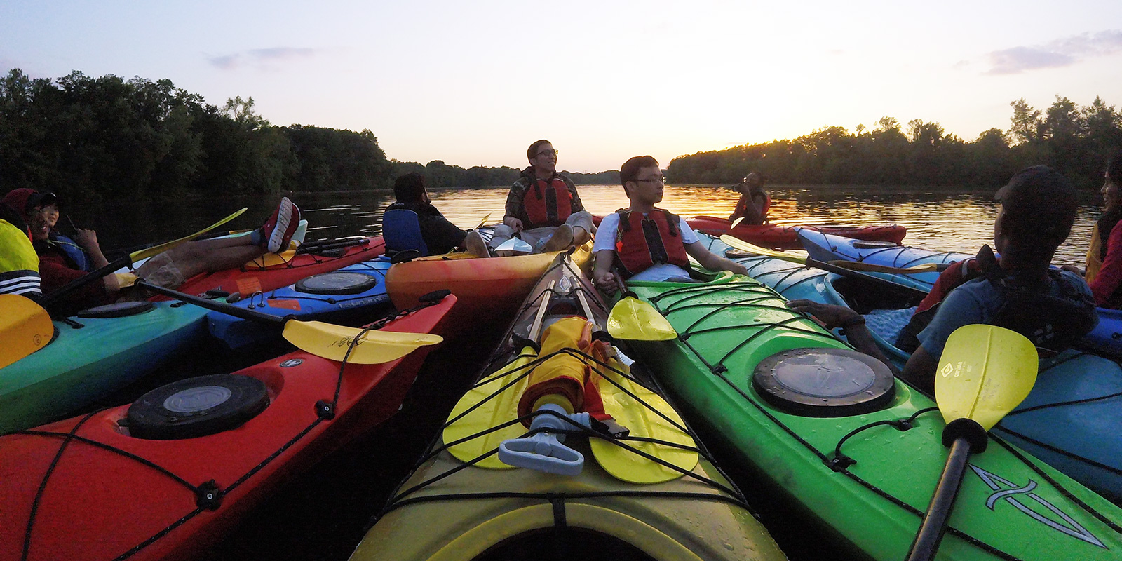Kayakers Relax at Sunset. At the UMass Lowell Kayak Center you can rent kayaks, canoes, stand-up paddle boards or sign up for kayaking instructional programs, tours and events!