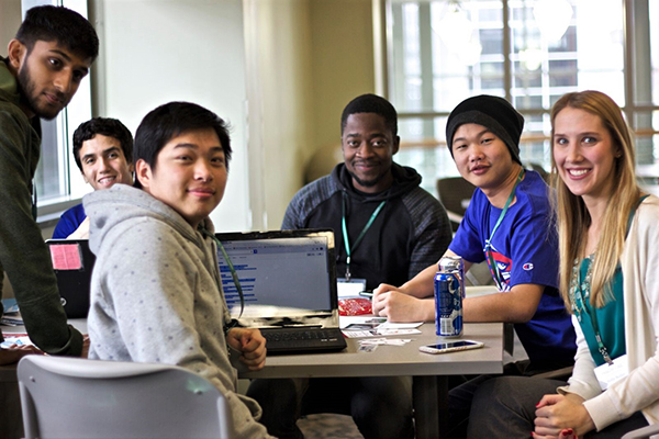 UMass Lowell students and Entrepreneurial Initiatives Project Director Holly Butler, right, prepare to hack at last year's Hackathon AE in Binghamton, N.Y.