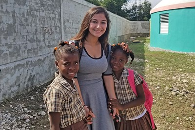 Civil and environmental engineering senior Nicole Belanger with her two new friends at Pwoje Espwa, Haiti