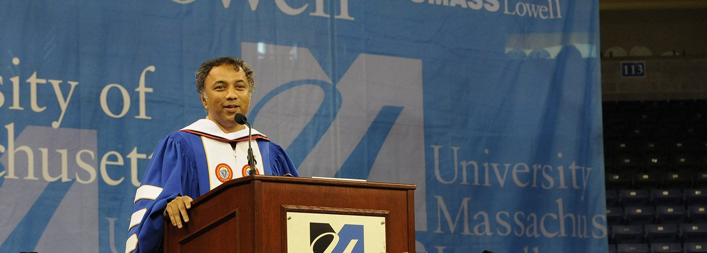 Harish Hande speaking at 2013 Graduate Commencement at UMass Lowell.