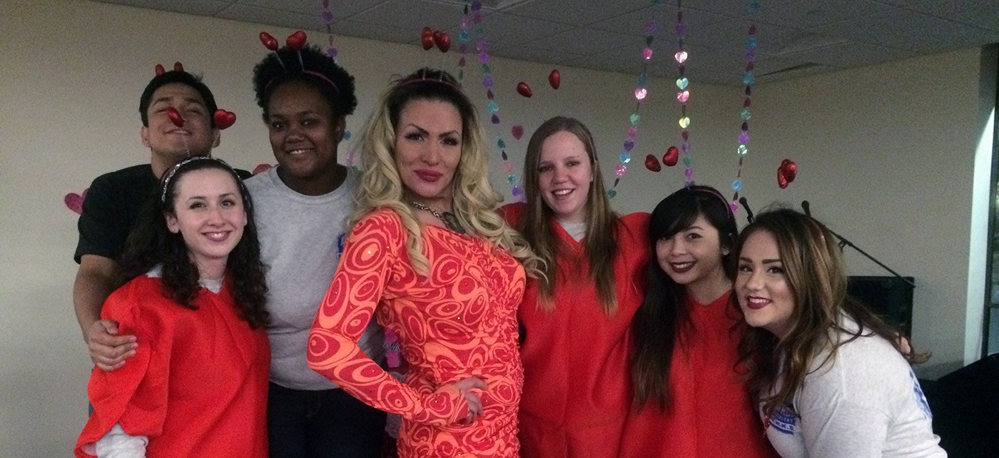 UMass Lowell students pose with a drag queen at the annual Health Education Sexapalooza event