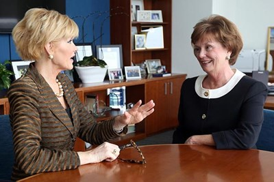 UMass Lowell Chancellor Jacqueline Moloney, right, talks with Herald columnist Judith Bowman about breaking the glass ceiling as a woman.