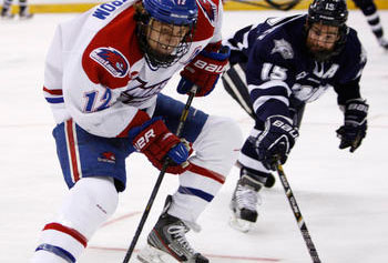 UMass Lowell's Josh Holmstrom maneuvers past New Hampshire's Brett Kostolansky as the River Hawks faced the Wildcats last night in a matchup at the NCAA Northeast Regional in Manchester, N.H., with a trip to the Frozen Four on the line.