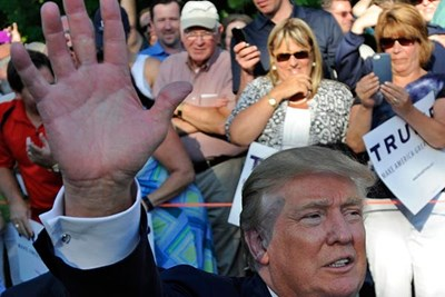 Photo by: Christopher Evans DROPPING IN: Presidential hopeful Donald Trump has made a number of trips to New Hampshire — including a June rally in Manchester, above, and an event in Laconia, below, last week. 1