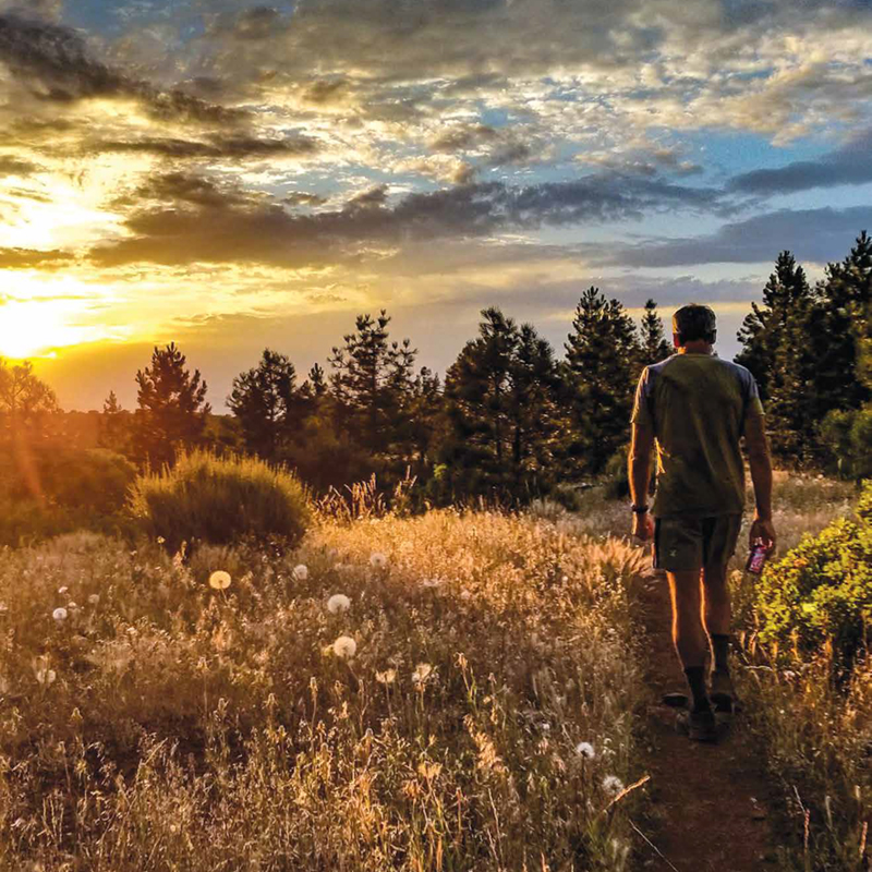 A sunset shot of Kyle Soeltz '14 hiking the Pacific Crest Trail