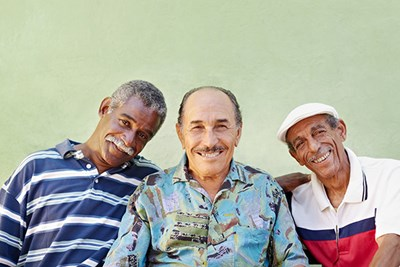 Three Puerto Rican men smiling