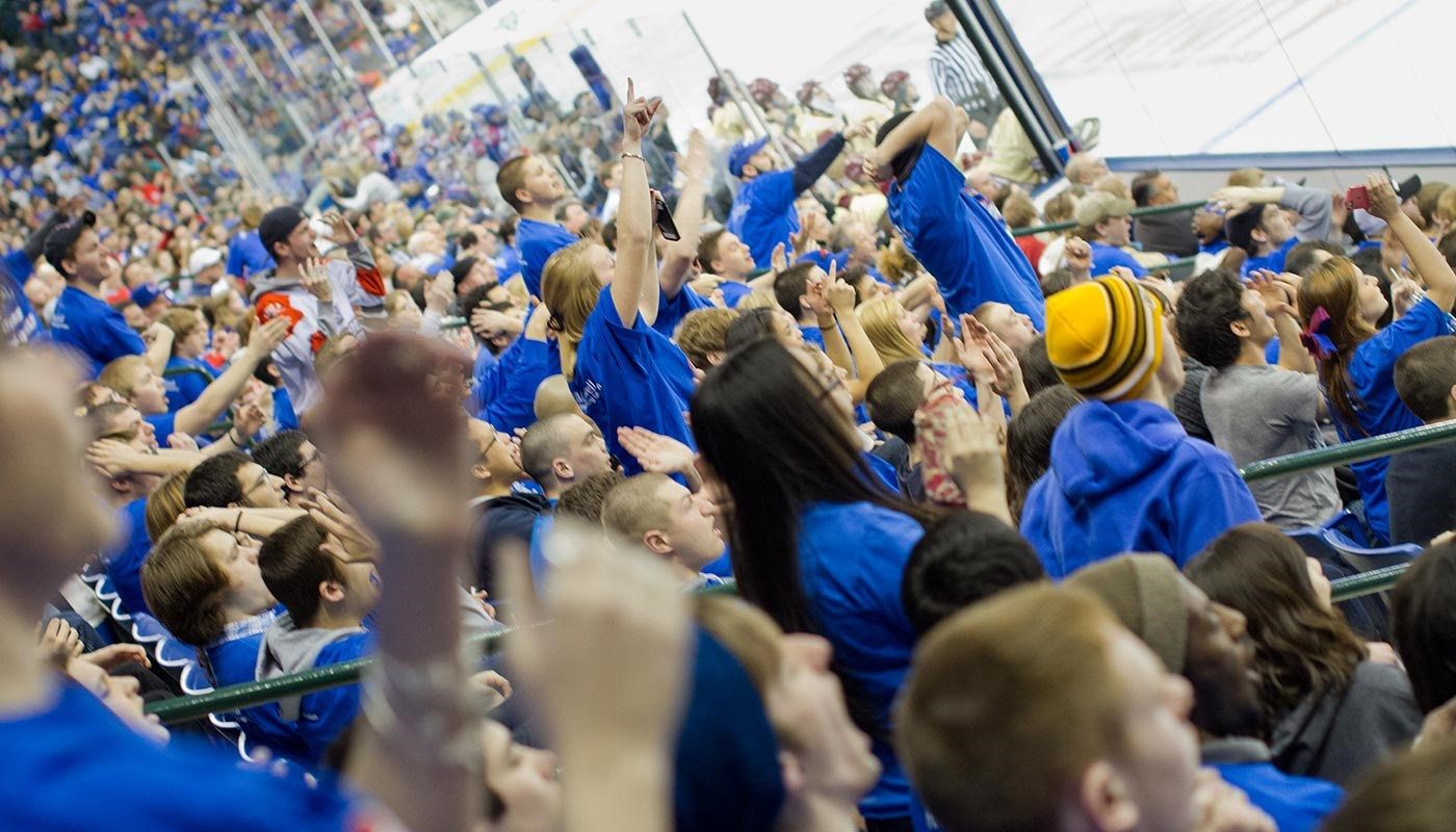 Students cheering at hockey game