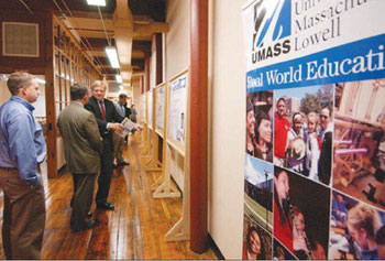 Visitors tour the 14,000-square-foot facility. Eight companies are calling the incubator home.