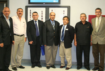 Engineering Dean John Ting, third from right, and Rachid Hankour of Geocomp Corp., far right, with the Iraqi delegation.
