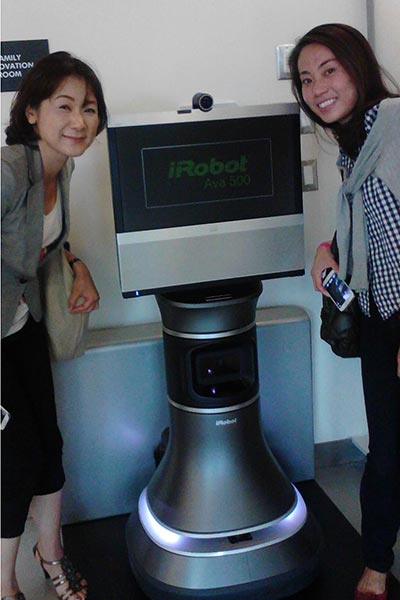 Students from UMass Lowell's Global Entrepreneurship Program tour iRobot.
