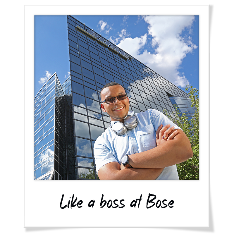"""Polaroid"" headshot of Jack Goutier standing outside the Bose global headquarters in Framingham with headphones around his neck - handwriting on photo frame reads ""Like a boss at Bose"""