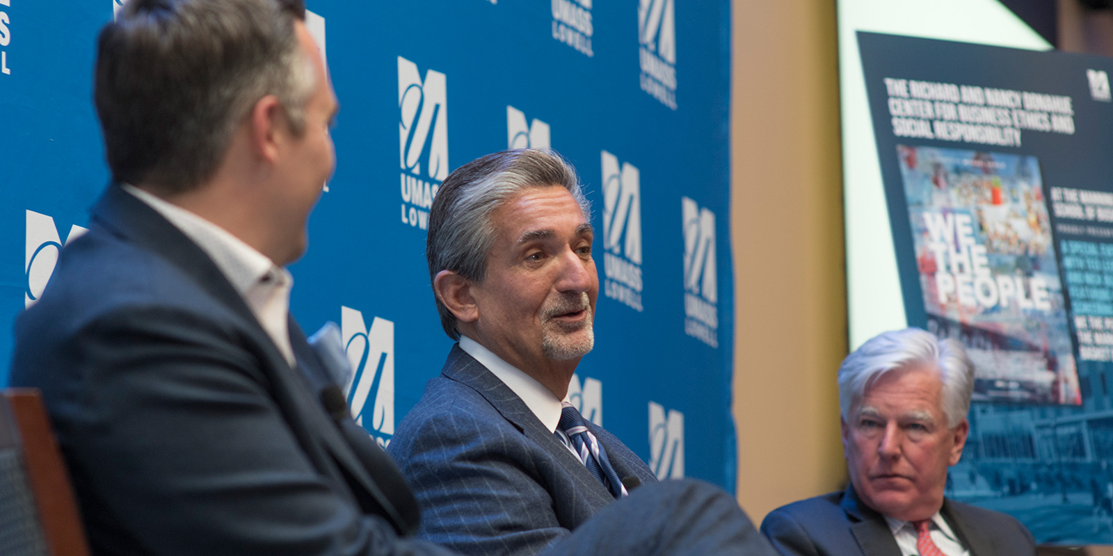 """Market Basket"" producers Nick Buzzell and Ted Leonsis, with UMass President Marty Meehan"