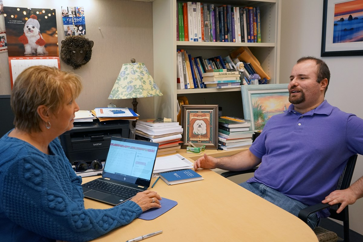 Jared Socolow meets with Associate Teaching Professor Mary Duell in her office.