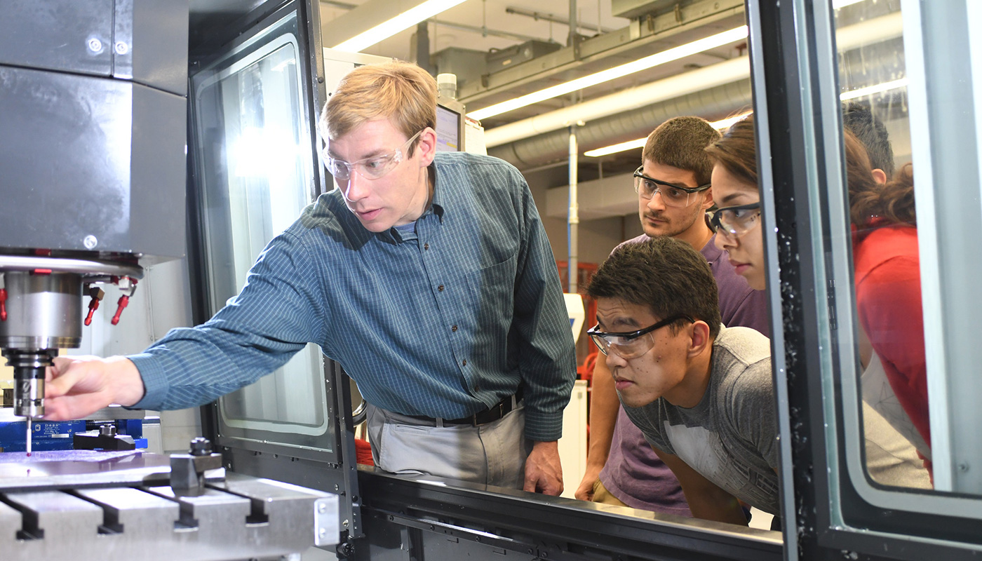 Steve Johnston in lab with students