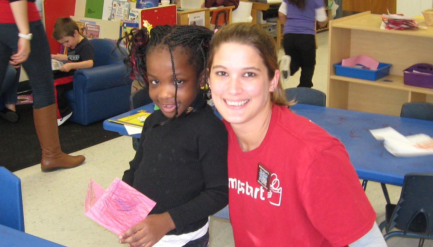 UMass Lowell student in the Jumpstart Program with preschooler.