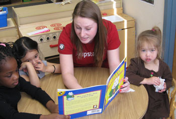UMass Lowell students participating in the Jumpstart program are working with preschoolers at the Children's Corner preschool in Lowell on literacy skills.