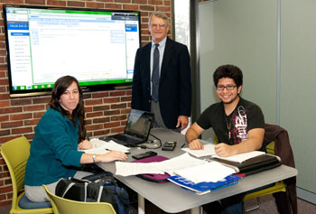 Commuter students Hannah Wallace, a freshman biology major, and junior Alvaro Molina, a plastics engineering major, chat with Paul Katen '64, whose donation created the new Katen Learning Commons in Lydon Library.