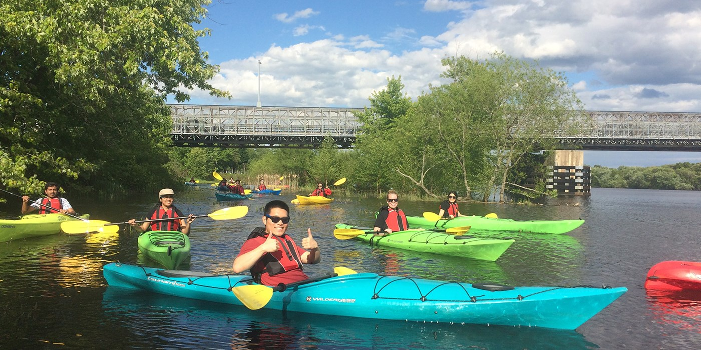 Enthusiastic Kayaker Gives Two Thumbs Up. At the UMass Lowell Kayak Center you can rent kayaks, canoes, stand-up paddle boards or sign up for kayaking instructional programs, tours and events!