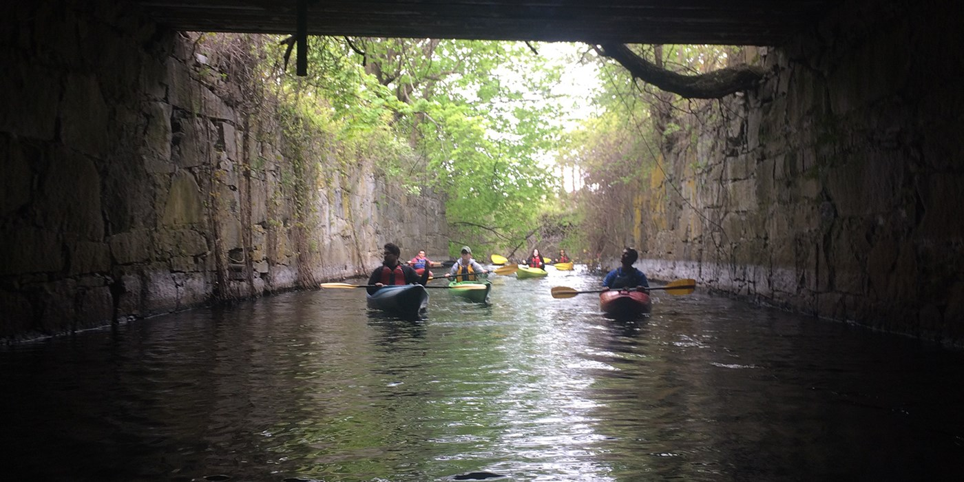Group of Kayakers Explore a Tunnel. At the UMass Lowell Kayak Center you can rent kayaks, canoes, stand-up paddle boards or sign up for kayaking instructional programs, tours and events!