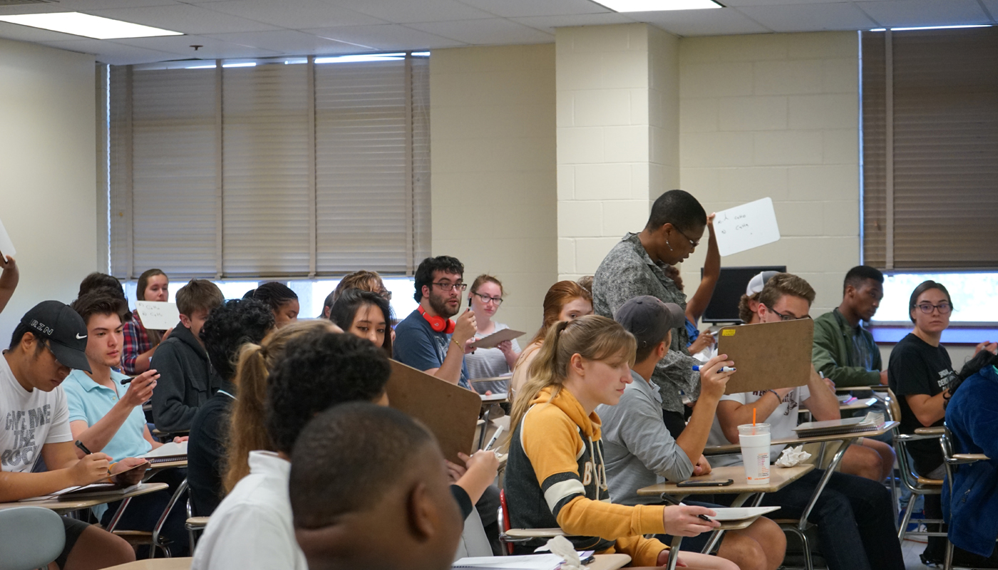 UMass Lowell organic chemistry professor Khalilah Reddie in a classroom full of her students