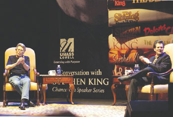 Best-selling horror-suspense writer Stephen King, left, joins fellow author Andre Dubus III on stage at the Tsongas Center at UMass Lowell Friday night for the inaugural event in UML's Chancellor's Speaker Series.