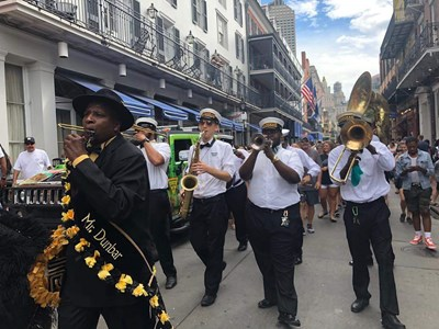 UML alum Seth Bailin (third musician from right) honks his sax way down in New Orleans with one of the street bands he play with, Knockaz, in the French Quarter.