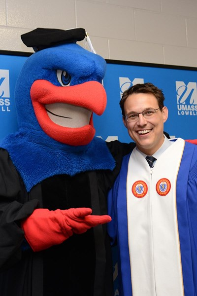Steve Kornacki and Rowdy the River Hawk before the morning ceremony.