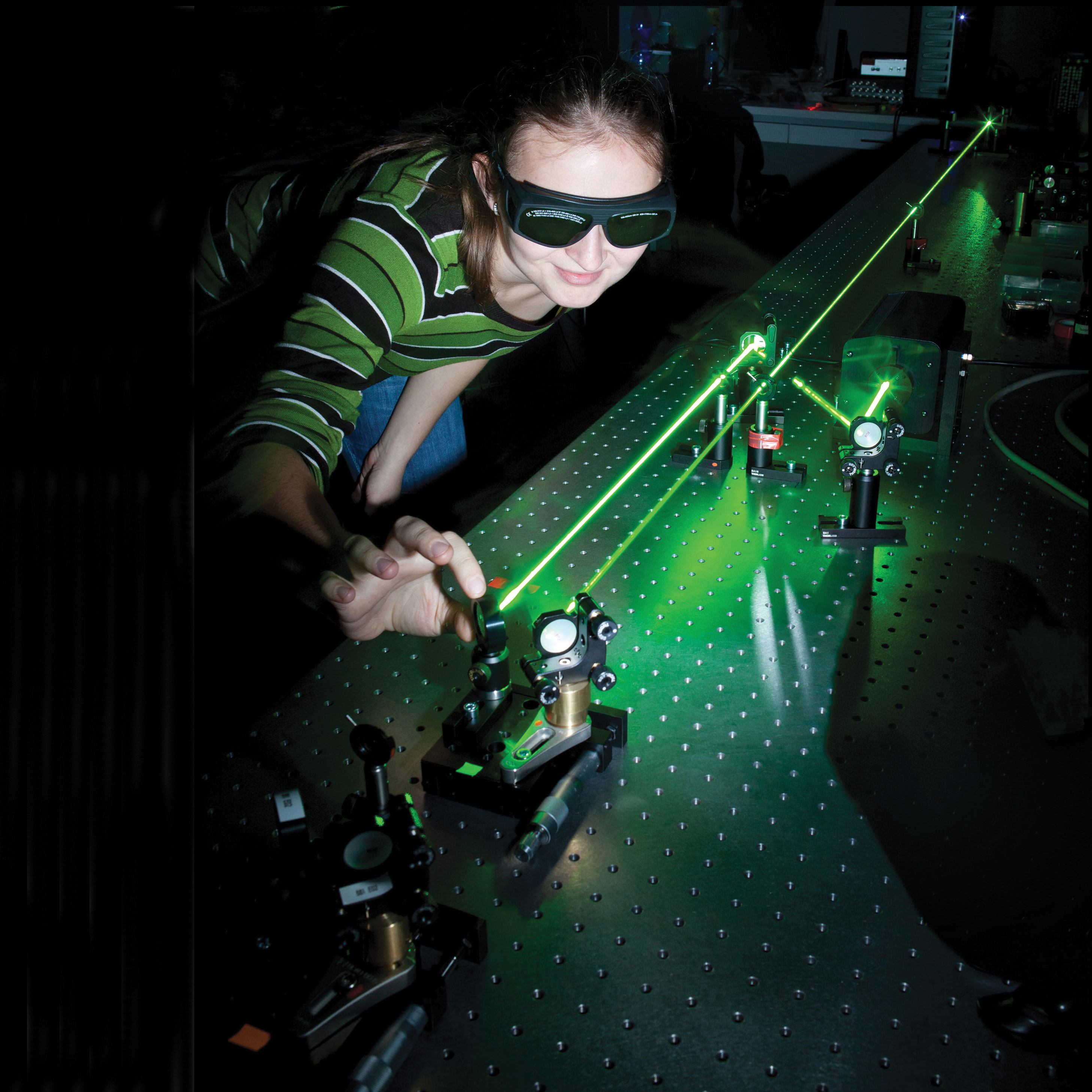female student in lab working with lasers
