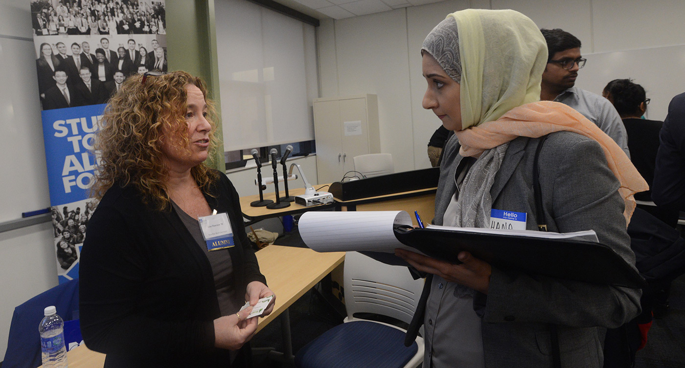 Life Sciences Career Night: woman talks to female student.