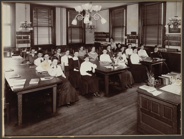 Female students seated at desks in classroom at Lowell Normal School in the 1900s