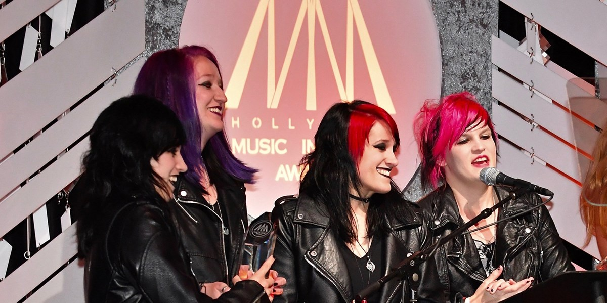 The band members of Flight of Fire onstage at the 2018 Hollywood Music in Media Awards