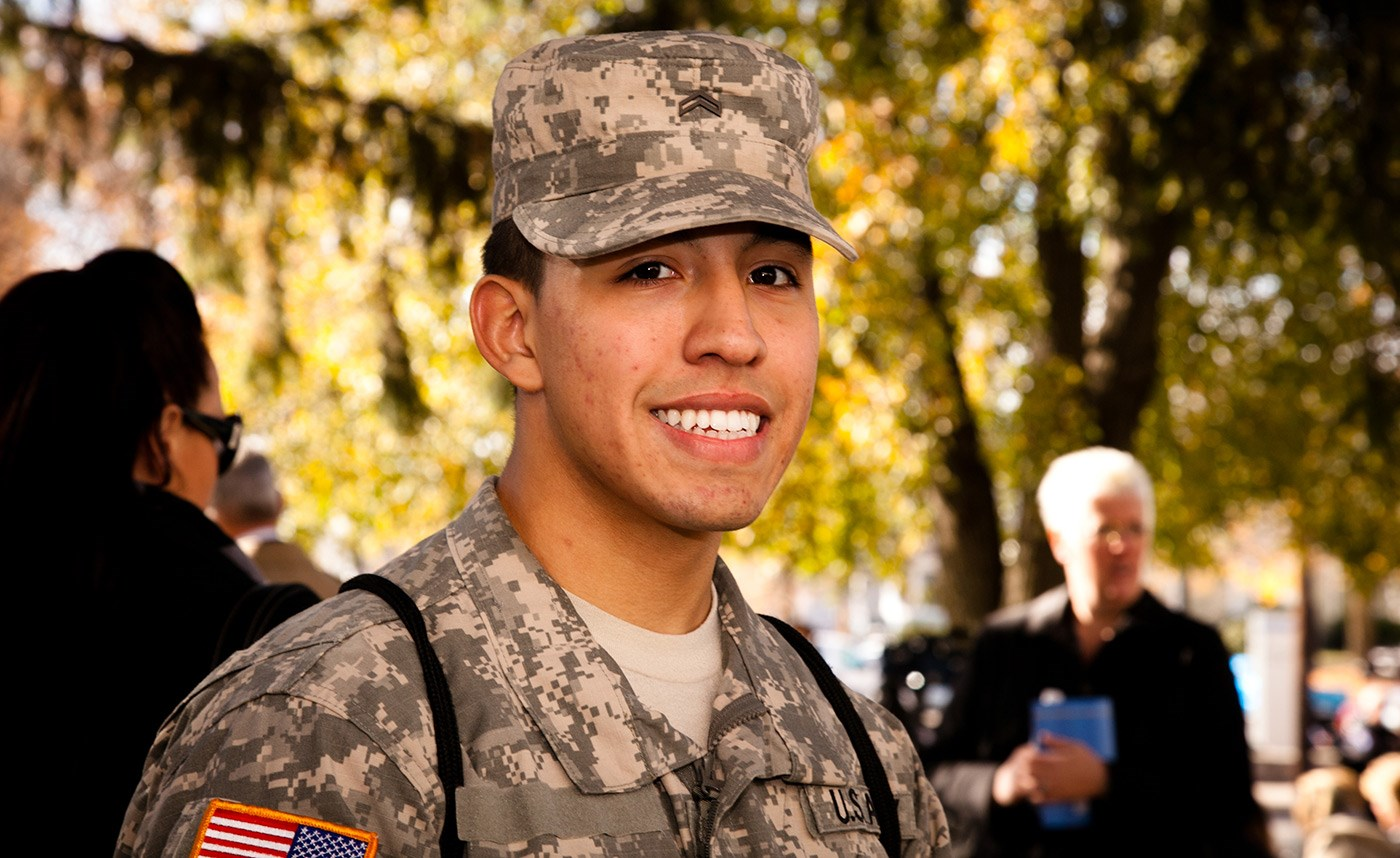 A UMass Lowell Army ROTC cadet smiles at a flag raising ceremony on Veterans Day.