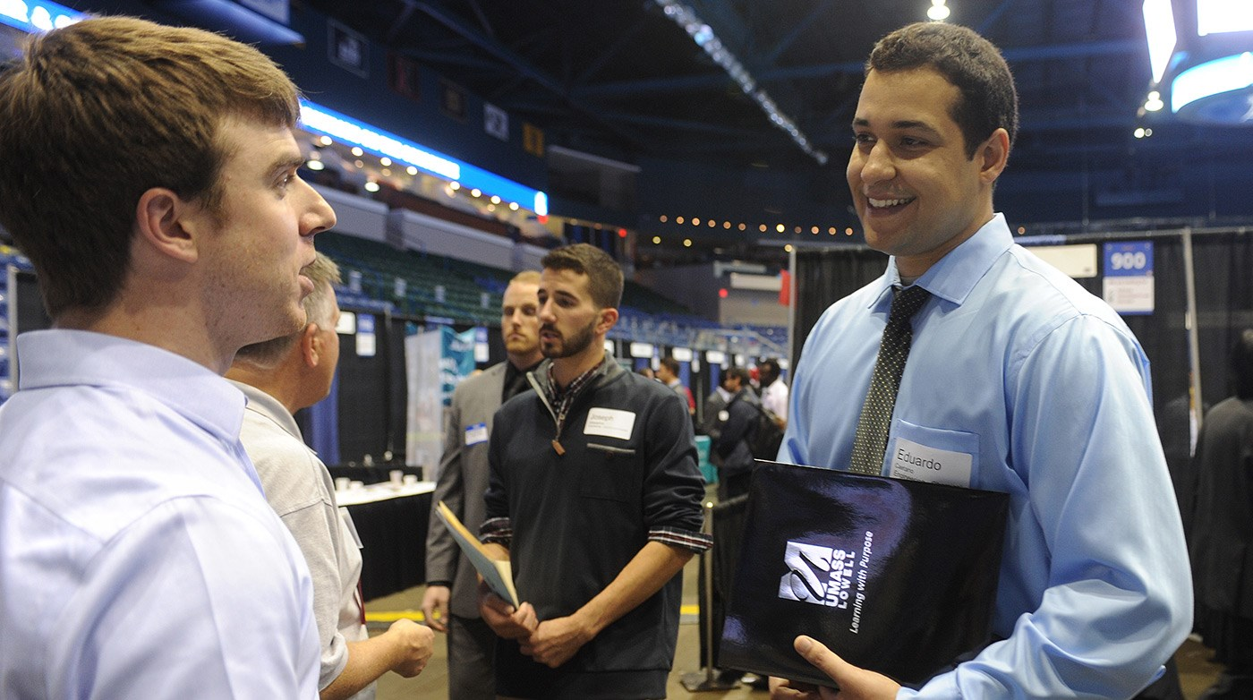 A student interacts with employers at the Career & Co-op Center's Career Fair at the Tsongas Center.