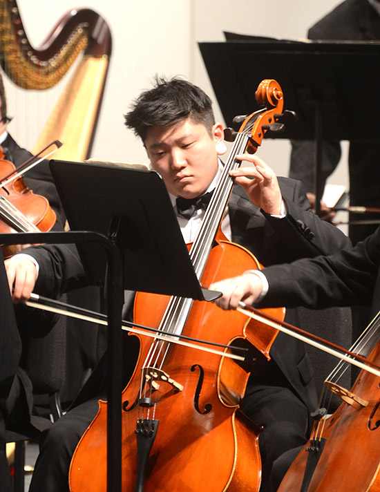 male-student-playing-bass-orchestra