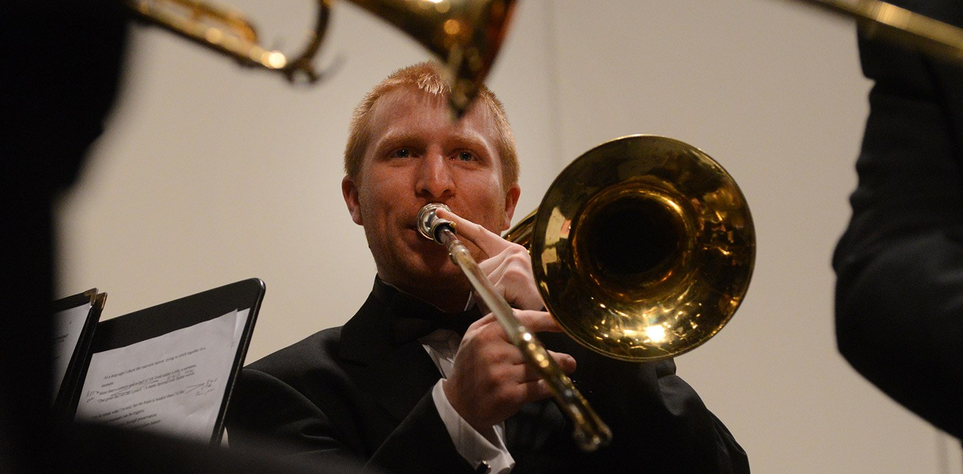 "A trombone player performs at the University Orchestra's ""All You Need is Love!"" Valentine's Day concert."