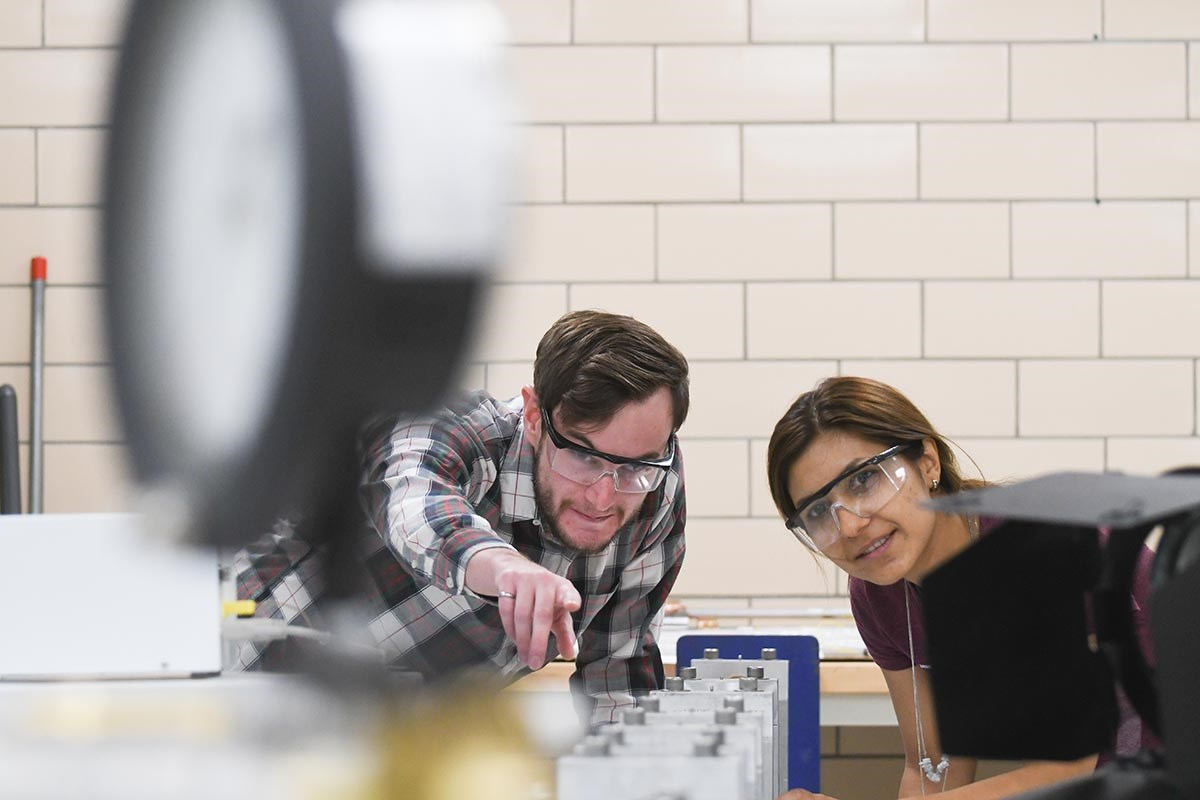 A man and woman in an engineering lab.