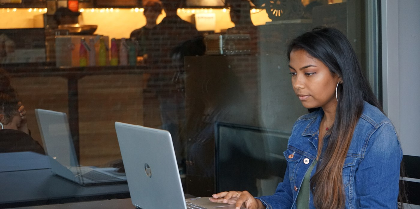 Marilyn Saha works on her laptop outside of Starbucks on South Campus