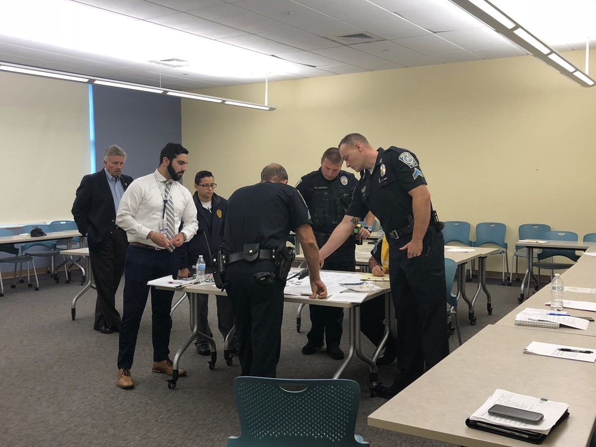 Matthew Chigas at his internship with the Nashua (N.H.) Office of Emergency Management, training other city offices and community organizations in security and emergency response.