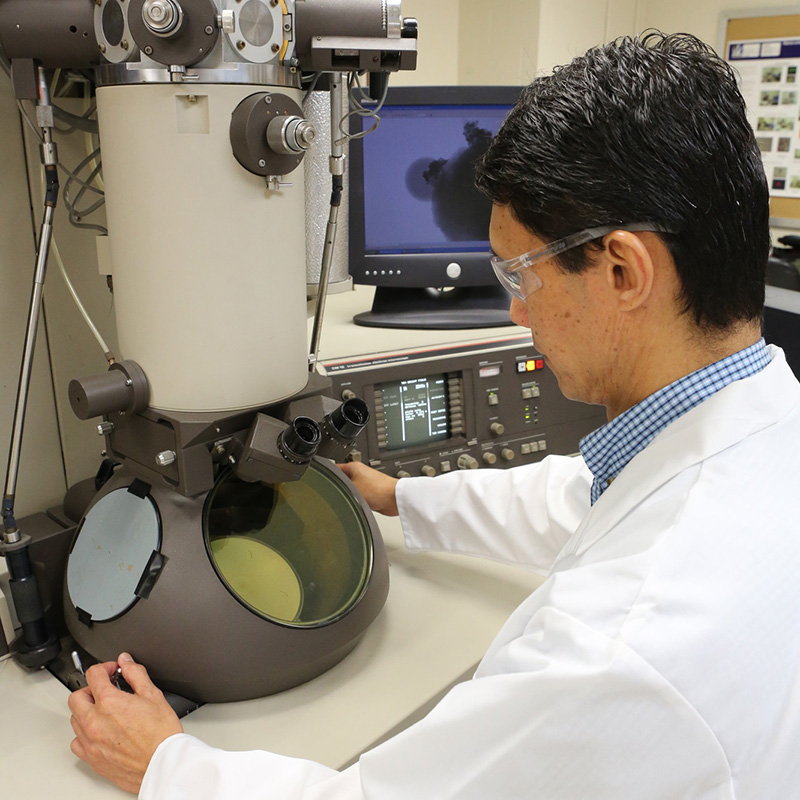 Man looking at piece of equipment in Material Characterization lab