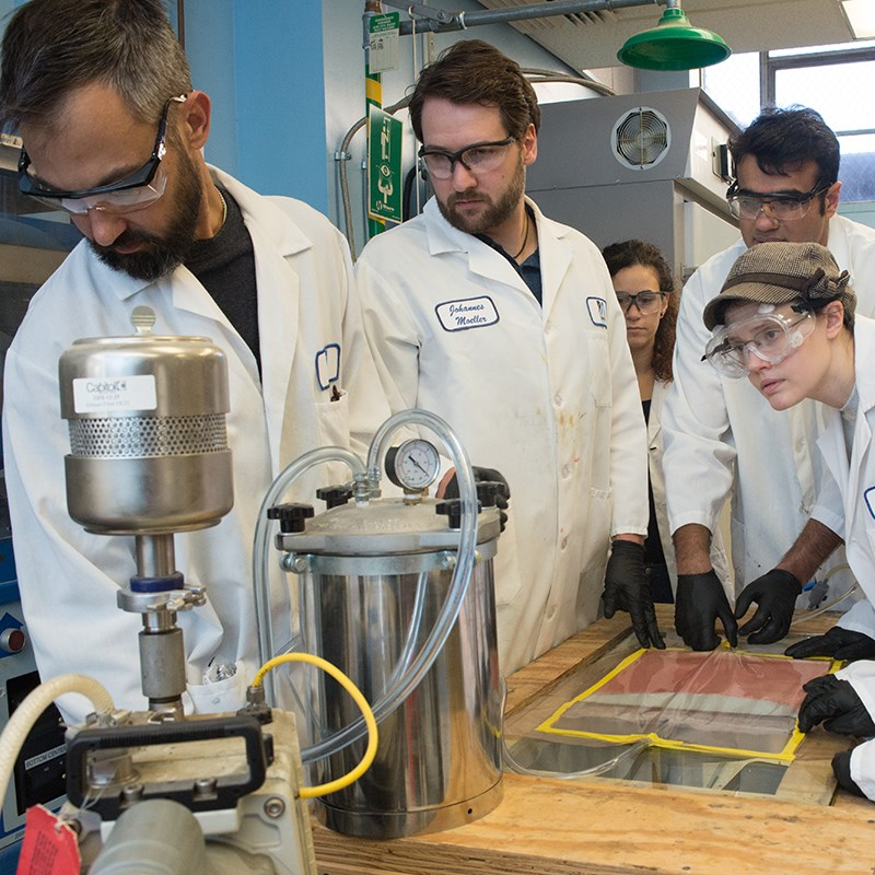 mechanical students and professor working in engineering lab