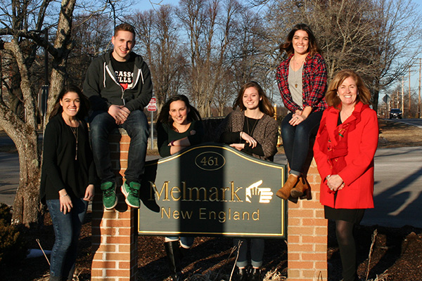 UMass Lowell students, from left, Kelly Freitas, Derek Kunze, Kristen Racamato, Alana Kelley and Jenna Freitas collaborated with Melmark CEO Rita Gardner, right, on student-created motion graphics.