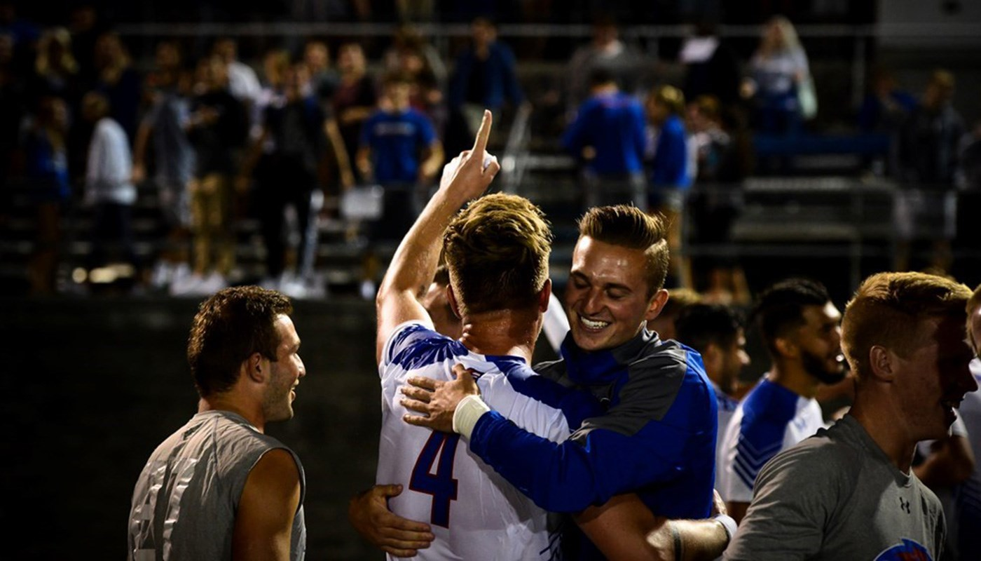 Men';s soccer players celebrate victory