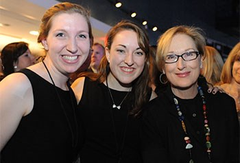 UMass Lowell students Janice Lane and Maddie Koufogazos with Meryl Streep