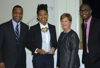 Student leader Weeldens Louis was awarded a MLK Distinguished Service Award by Office of Multicultural Affairs Director David Jones, left, Executive Vice Chancellor Jacqueline Moloney and graduate student Andrade Fearon.