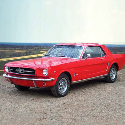 Photo of a 1965 red Ford Mustang