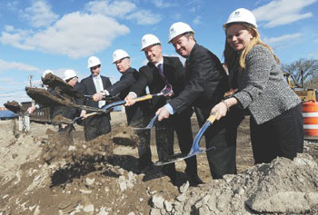 UMass Lowell and city officials break ground on new dorms across from LeLacheur Park in Lowell yesterday. From left are President and CEO of Walsh Bros. Inc., Richard Walsh; Mayor Patrick Murphy; UML Chancellor Marty Meehan; state Rep. Thomas Golden; President of Mass Trades Frank Callahan and Executive Director of UMass Building Authority Katherine Craven.