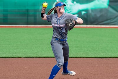 UMass Lowell shortstop Courtney Cashman fields a softball during game