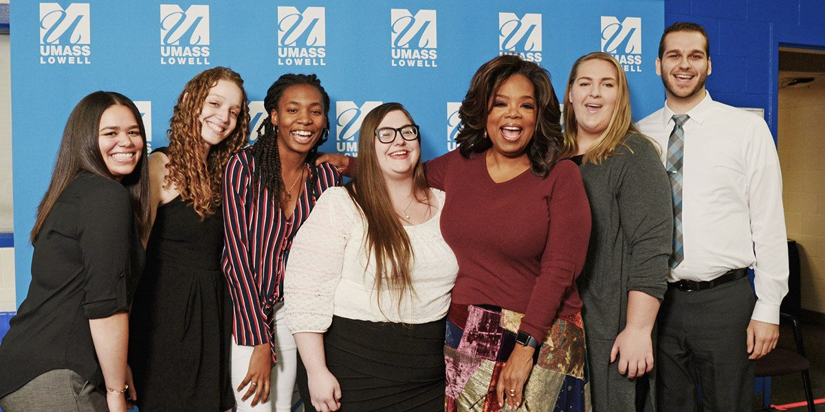 Oprah Winfrey with student scholarship winners