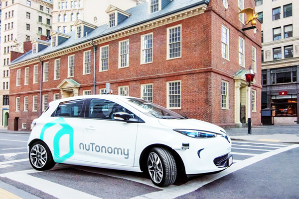 A photo of a nuTonomy car on the road in Boston's Seaport district